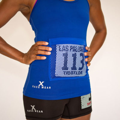 Women's racerback tank top with bib protector pocket in blue